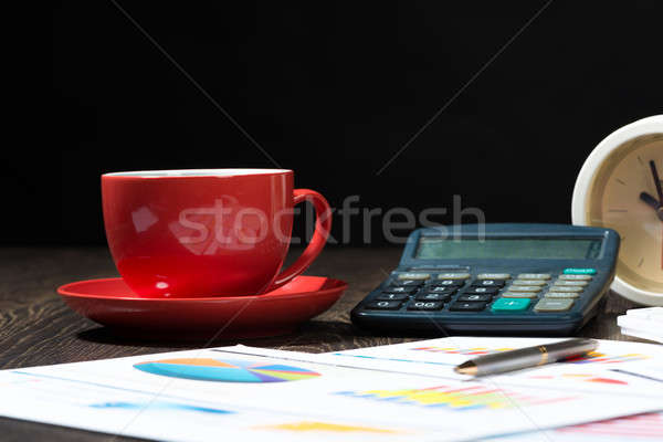 calculator, business papers and a cup of coffee Stock photo © adam121