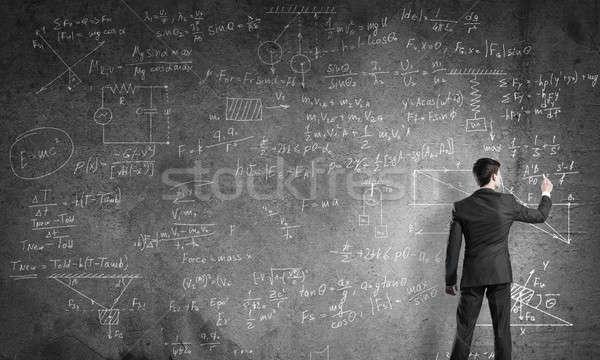 Leraar Blackboard man pak permanente Maakt een reservekopie Stockfoto © adam121