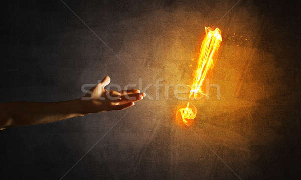 Concept of attention or punctuation with burning exclamation mark on dark background Stock photo © adam121