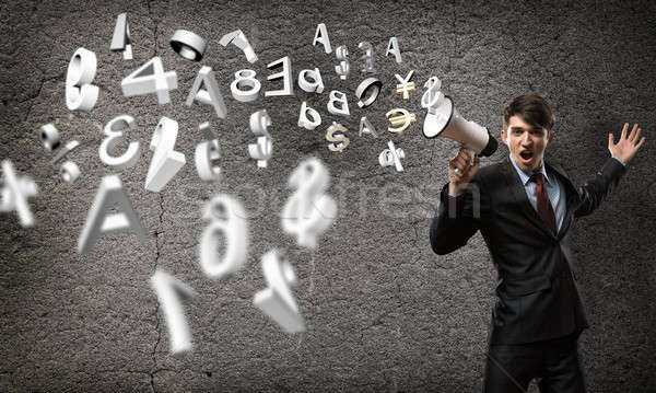businessman shouting into a megaphone Stock photo © adam121