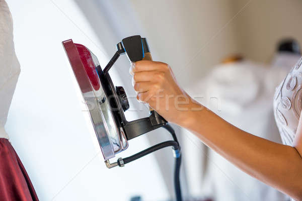 Stock photo: Woman holding iron