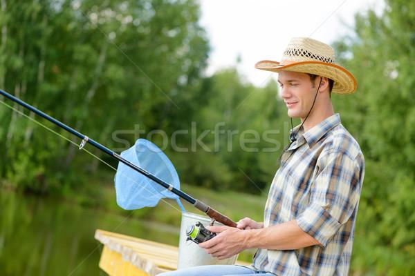 лет рыбалки красивый молодым человеком сидят пирс Сток-фото © adam121