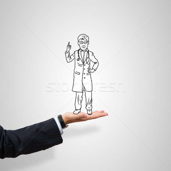 Caricatures of businessman in palm Stock photo © adam121