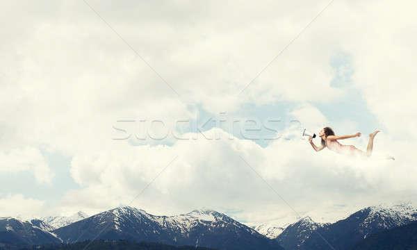 Libre express jeune femme mégaphone battant élevé Photo stock © adam121