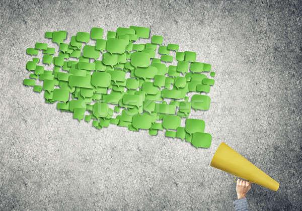 Mão mulher verde papel trombeta Foto stock © adam121