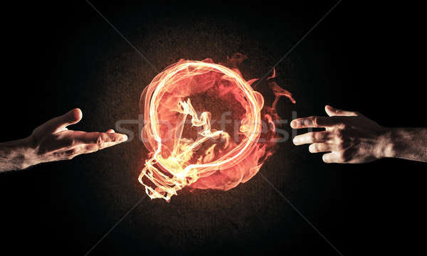 Concept of electricity or inspiration with burning light bulb an Stock photo © adam121