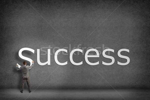 Businessman collects on the wall the word success Stock photo © adam121