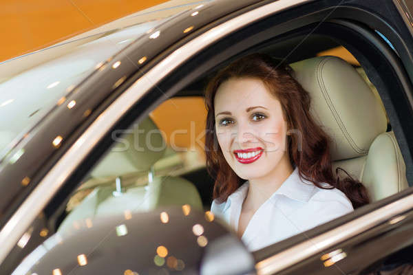 Genç kadın yeni araç showroom gülen bakıyor kamera Stok fotoğraf © adam121