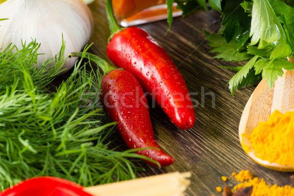 Peperoncino erbe spezie mentire legno superficie Foto d'archivio © adam121