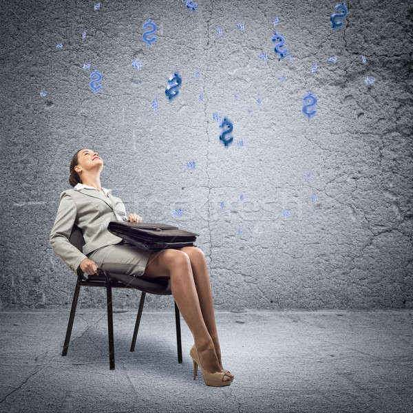 Young business woman looking up Stock photo © adam121