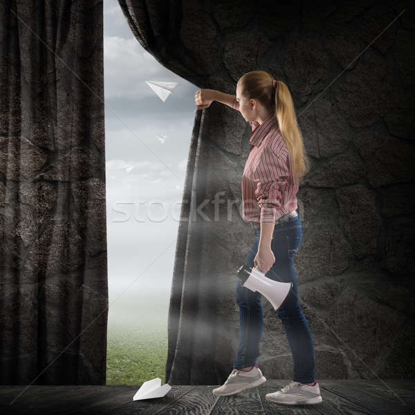 young woman pushes the curtain looking at clouds Stock photo © adam121