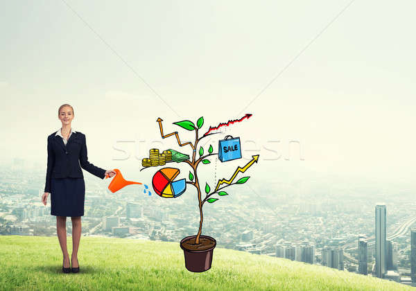 Young businesswoman outdoors watering drawn growth concept with  Stock photo © adam121