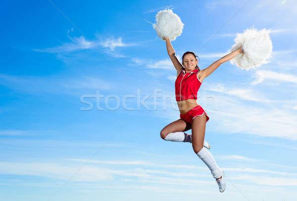 Stok fotoğraf: Genç · amigo · kırmızı · kostüm · atlama · mavi · gökyüzü