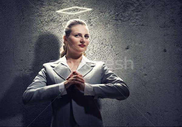 Pregando imprenditrice giovani santo halo sopra Foto d'archivio © adam121