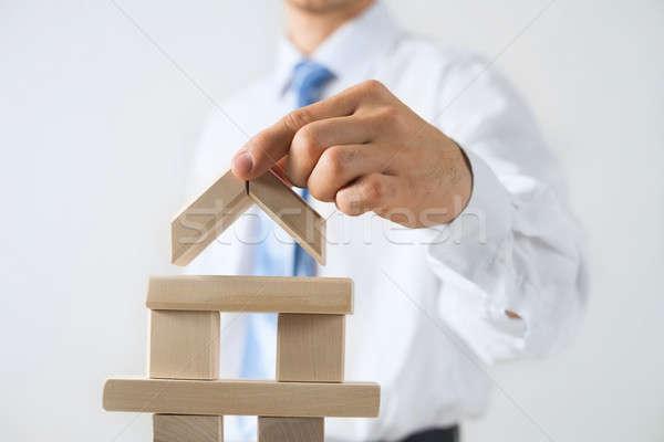 üzletember készít torony közelkép épület fakockák Stock fotó © adam121