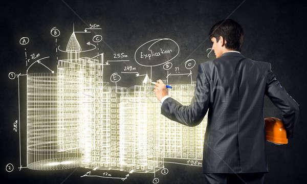 Indústria da construção ver de volta homem engenheiro desenho construção Foto stock © adam121