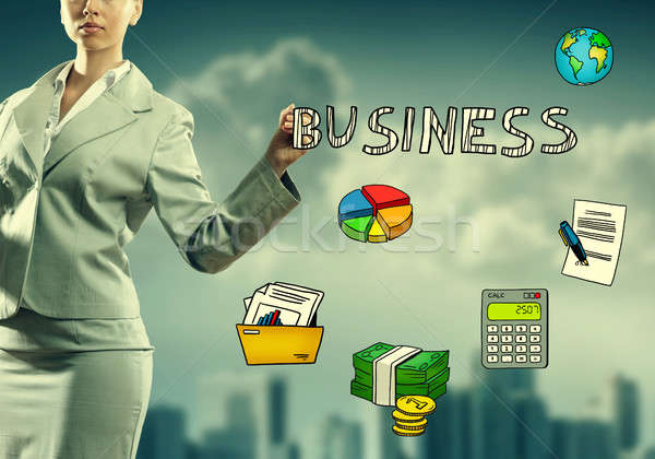 Woman drawing business icons Stock photo © adam121