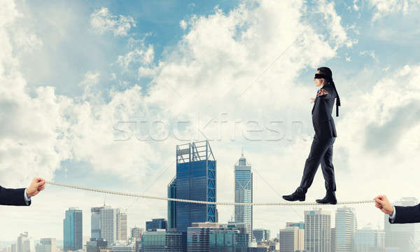 Business concept of risk support and assistance with man balanci Stock photo © adam121