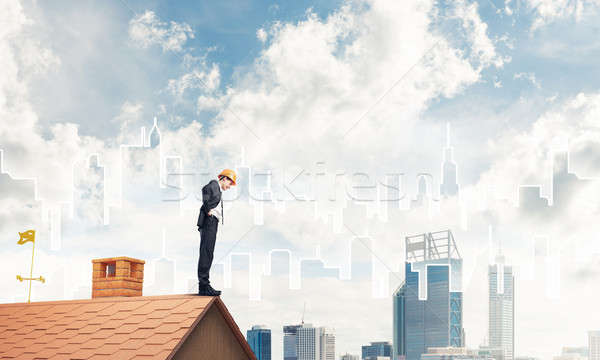 Engineer man standing on roof and looking down. Mixed media Stock photo © adam121