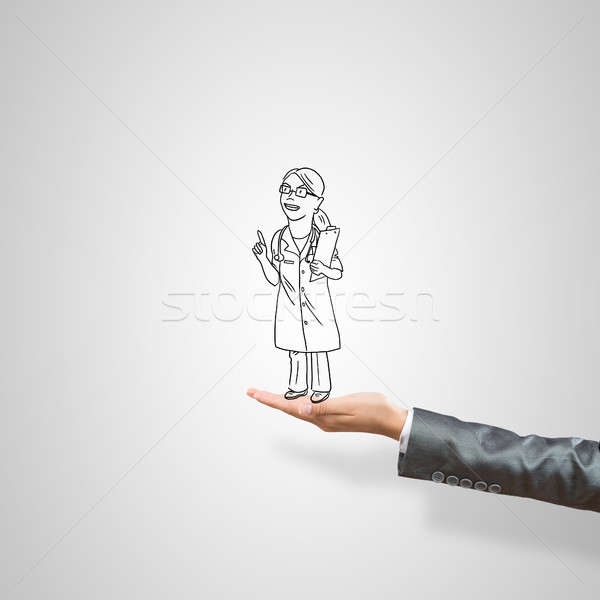 Caricatures of woman in palm Stock photo © adam121