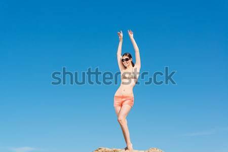 Dziewczyna strój kąpielowy broni uśmiecha Błękitne niebo piękna Zdjęcia stock © adam121