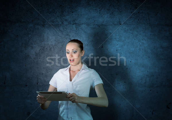 young attractive woman holding a tablet Stock photo © adam121
