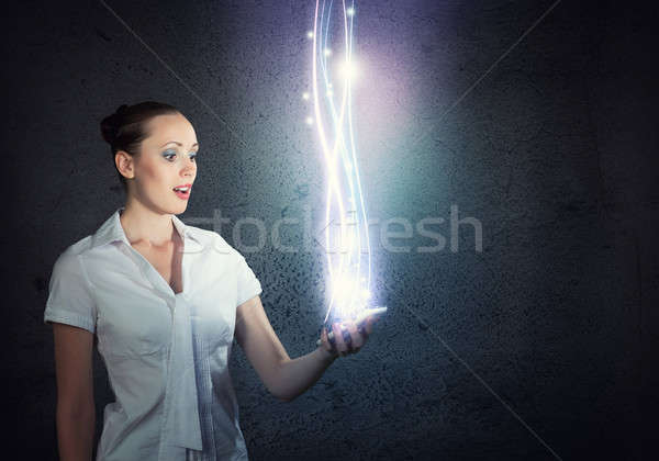 young attractive woman holding a cell phone Stock photo © adam121