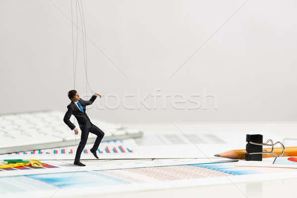 businessman puppet doll is on the desk Stock photo © adam121