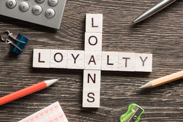 Loans and loyalty crossword puzzle collected of game wooden cubes Stock photo © adam121