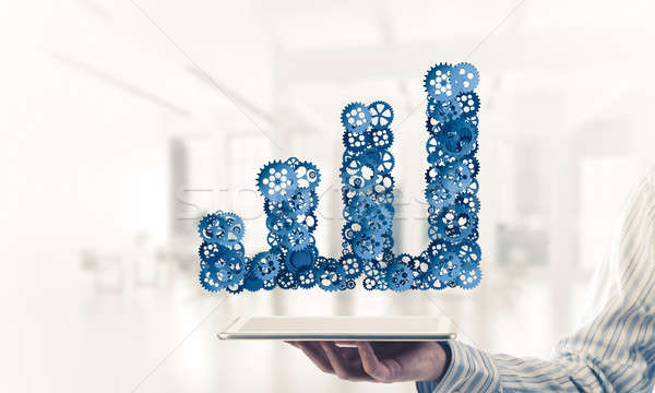 Close of businessman holding tablet pc with progressing graph ic Stock photo © adam121