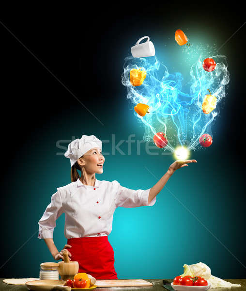 Asian woman chef juggling with vegetables in the kitchen conjures Stock photo © adam121
