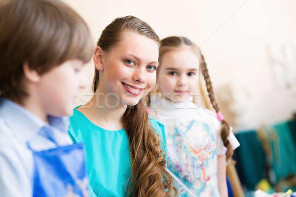 Crianças professor comprometido pintura arte escolas Foto stock © adam121
