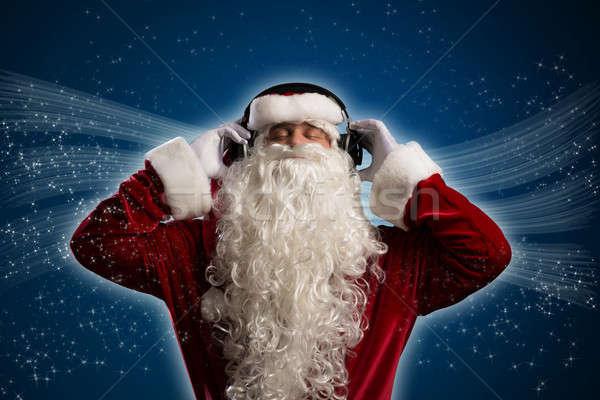 Santa Claus is listening to music Stock photo © adam121