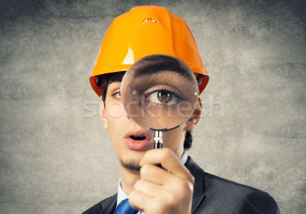 Construction man with magnifier Stock photo © adam121