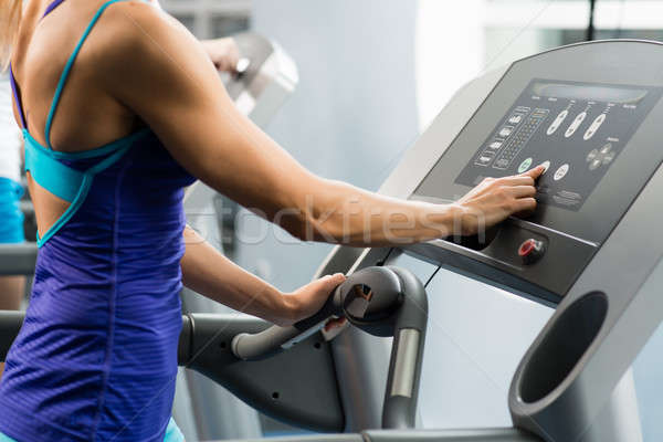woman adjusts the treadmill Stock photo © adam121