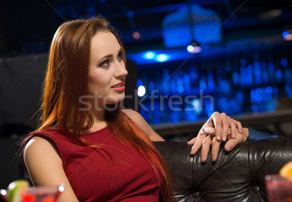 Portrait of an attractive woman in a nightclub Stock photo © adam121