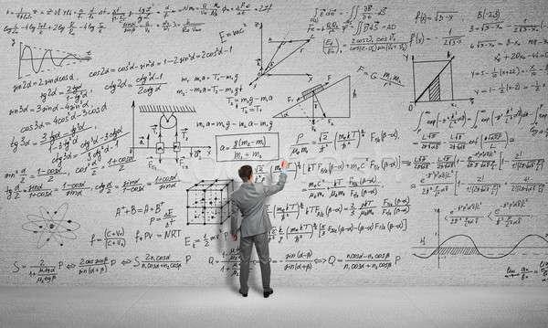 Homme tirer science formules vue arrière étudiant Photo stock © adam121