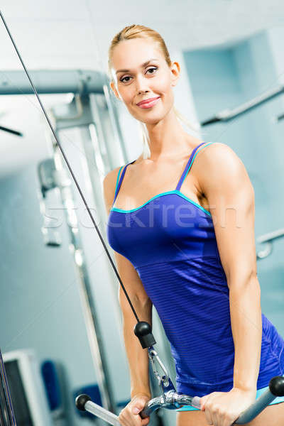 young woman doing body-building in the Gym Stock photo © adam121