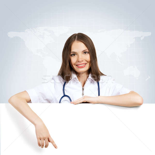 young woman doctor with a blank banner Stock photo © adam121