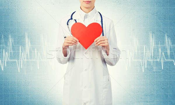 Kontrol kalp genç kadın doktor mavi Stok fotoğraf © adam121