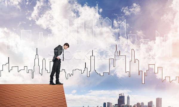 Imprenditore guardando verso il basso tetto moderno cityscape mista Foto d'archivio © adam121