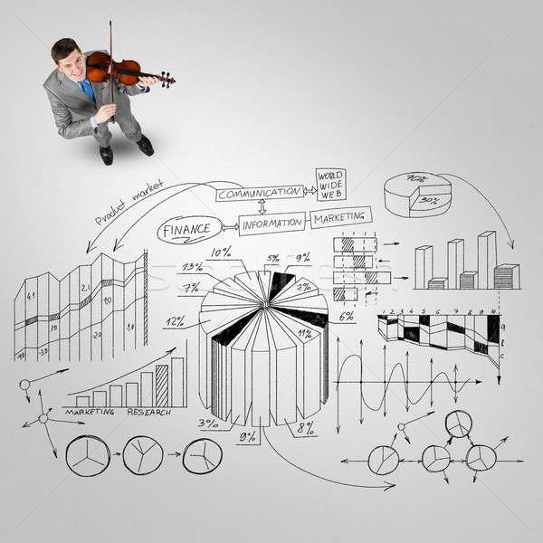 Сток-фото: бизнесмен · играть · успех · мелодия · Top · мнение