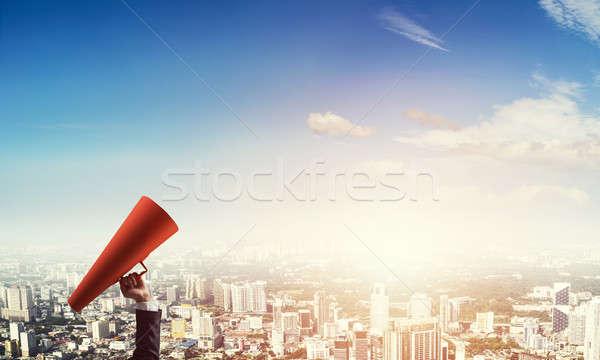 ストックフォト: 手 · 女性実業家 · 赤 · 紙 · トランペット