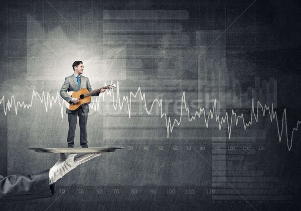 Işadamı Metal tepsi oynama akustik gitar grafikler Stok fotoğraf © adam121