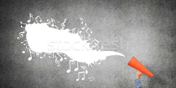 Mão homem laranja papel trombeta Foto stock © adam121