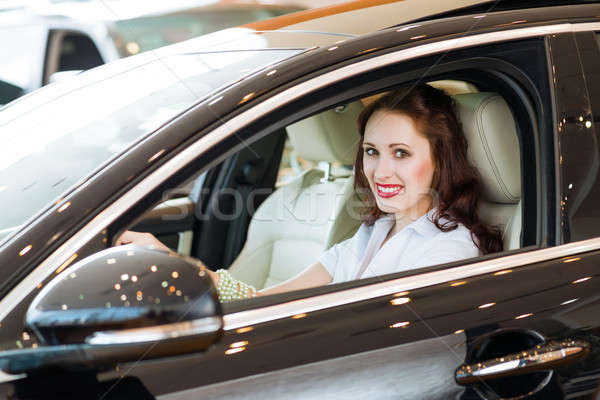 young woman in the new car in the showroom Stock photo © adam121