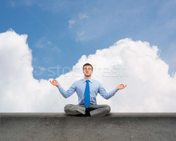 businessman meditating Stock photo © adam121