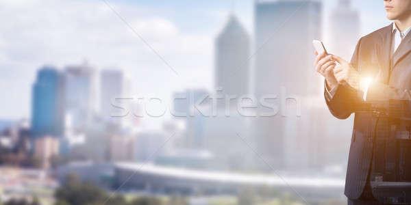 Stock photo: Businessman use mobile phone