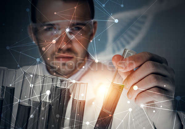 Portrait of concentrated male scientist working with reagents in laboratory Stock photo © adam121