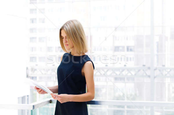 Stock photo: business woman holding reports. Copy space
